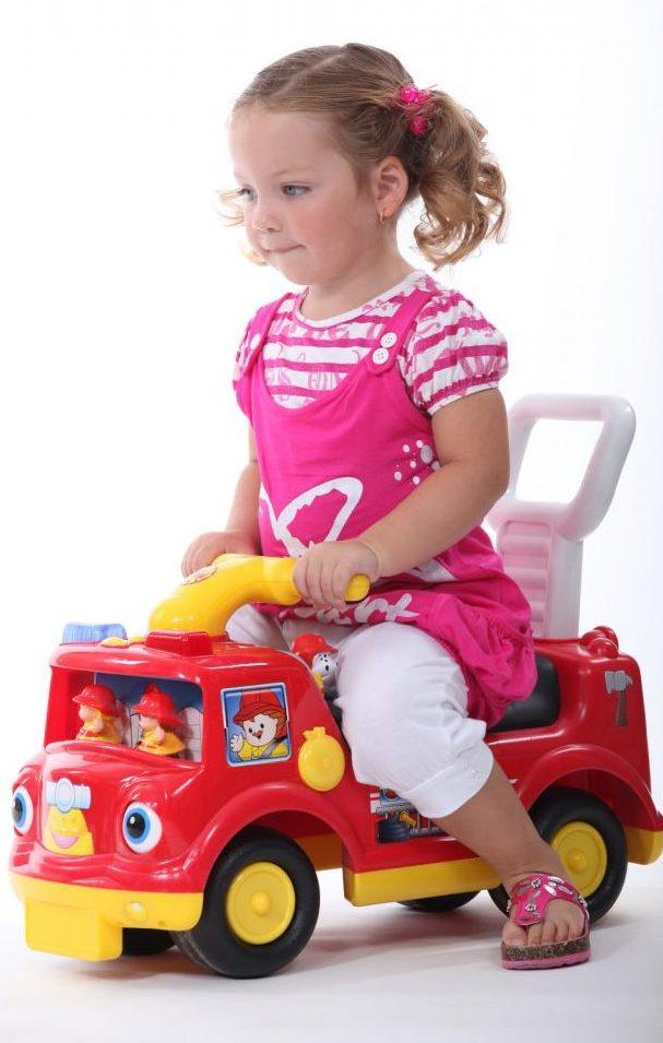 little-girl-sat-on-toy-truck[1]